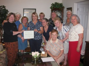 Literature Group accepts 40th Aniversary Certificate from AAUW